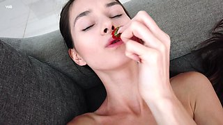 Young beauty Victoria is eating strawberry and masturbating pussy