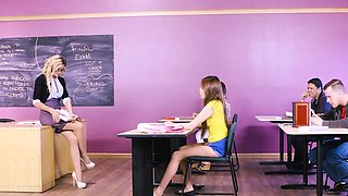 Female teacher fucks in class with young student