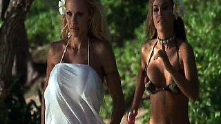 Carmen Electra wearing bikini top as she starts dancing for