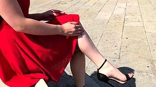 Elegant blonde teen in high heels exposes her feet outside