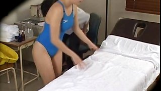 Asian in swim suit gets sexy body massaged