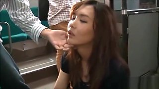 Asian girl reluctantly blows a couple guys on a bus after they strip her
