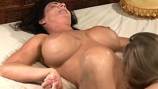 Big-titted MILF has sex with a lesbian chick