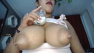 Busty Latina Elena milks tits and sucks straight from source