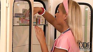Hot Blonde Nurse In Pink Latex