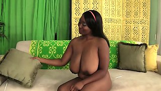 Black plumper gets naked and rubs her pussy before she