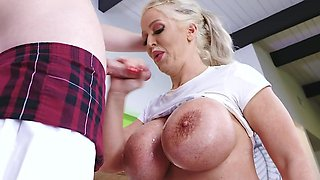 Blonde MILF with massive tits gives a blowjob