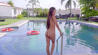 Slender Latin girl Karin Torres takes off bikini and shows off her pussy by the pools side