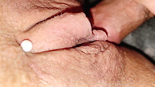 Fucking her pierced pussy, pulsing clit squirts on cock