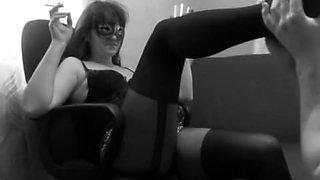 Masked brunette in lingerie has her slave licking her cunt