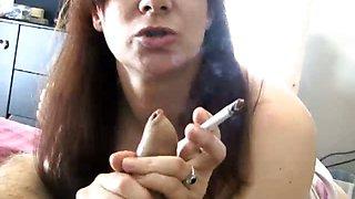 Brunette slut sucking cock while smoking