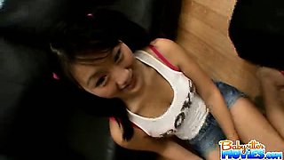 Asian innocent babysitter Evelyn shows off her tiny tits