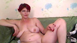 Redheaded mature slut gives a show on a sex webcam