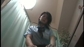 Kinky doctor examines cute Japanese schoolgirl cunt and tits