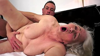 Guy makes old blonde whore happy fucking her in spoons position