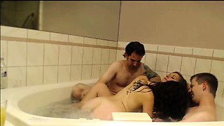 Lustful swingers engage in wild group sex in the hot tub
