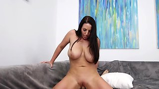 Brunette babe with big boobs sucks and rides a big cock