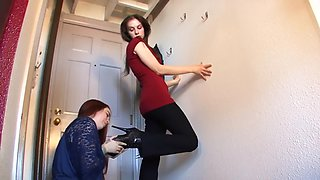 Sexy girl licks boots of her mistress
