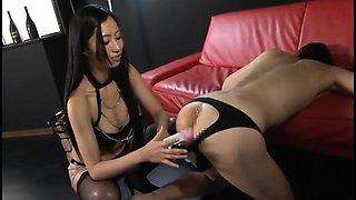 Hot Asian dominatrix buries a dildo inside her slave's ass